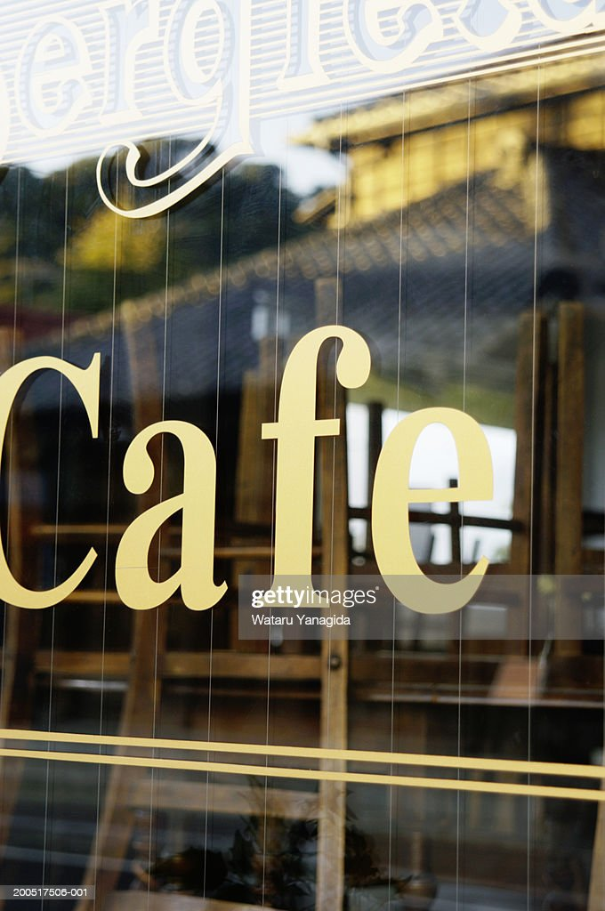 Cafe, view through window (focus on 'Cafe' sign) : Stock Photo