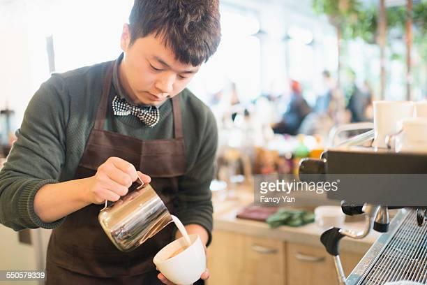 cafe waiter making coffee