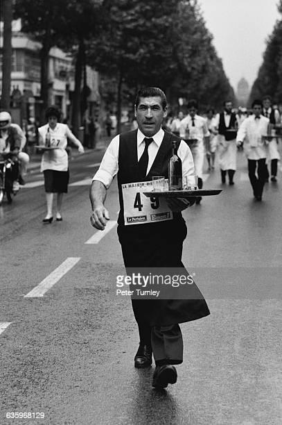 Cafe waiters race on a Paris boulevard