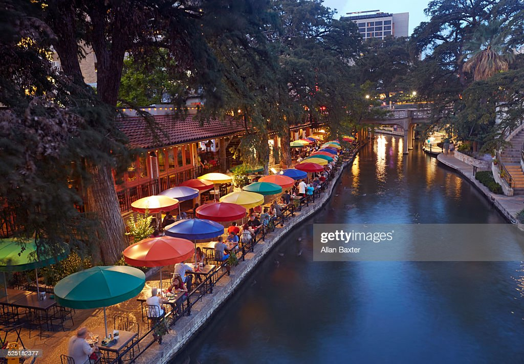 Cafes along San Antonio River Walk at dusk