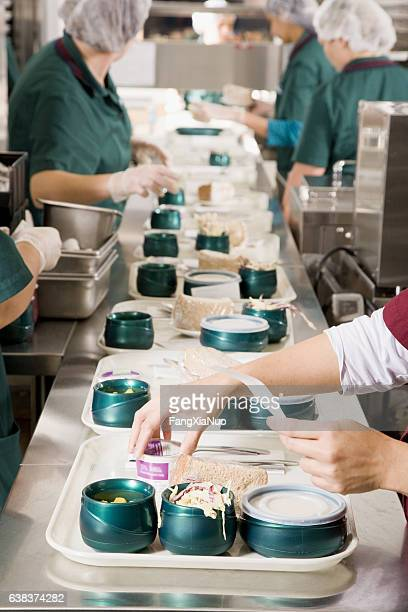 Cafeteria kitchen service cooks preparing meals in hospital