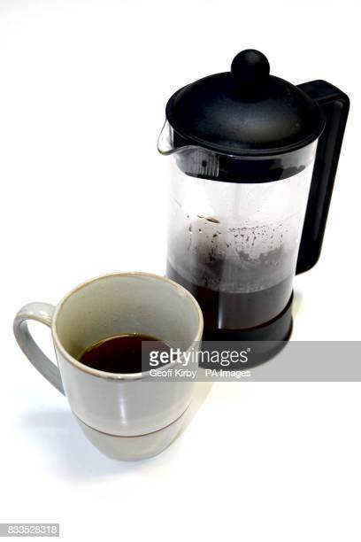 A cafetiere and coffee mug