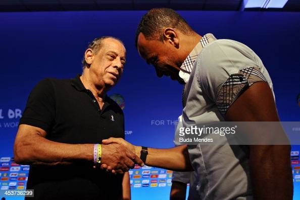 Cafu greets Carlos Alberto Torres on stage after the FIFA World Cup Ambassadors Press Conference during a media day ahead of the 2014 FIFA World Cup...