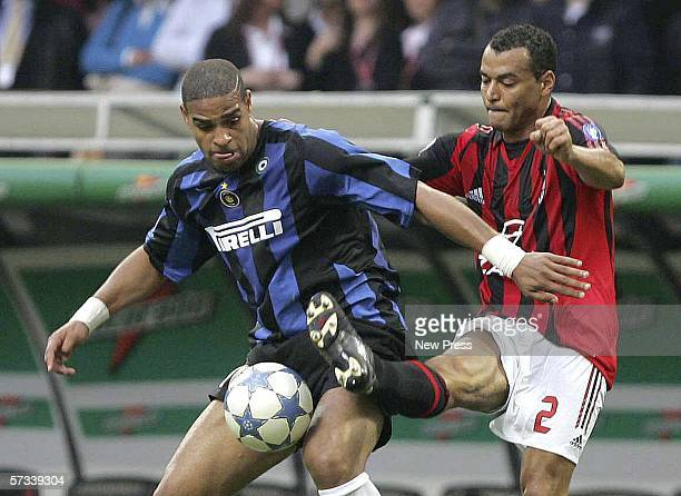 Cafu of AC Milan challenges Adriano of Inter during the Serie A match between AC Milan and Inter Milan at the San Siro on April 14 2006 in Milan...