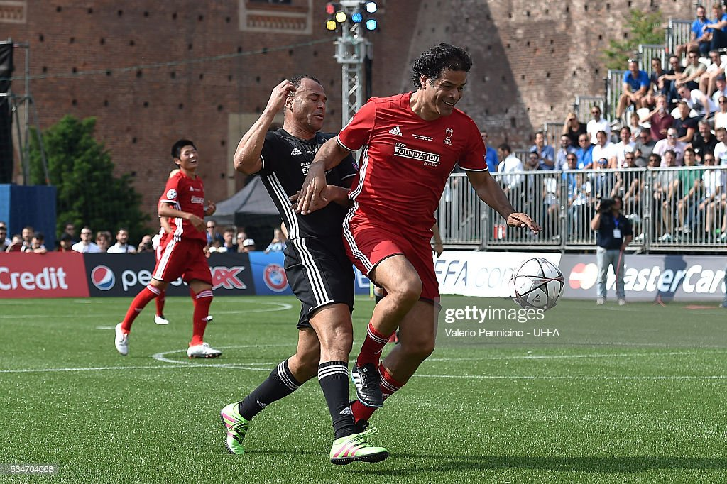 Cafu (L) of AC Milan & Inter Legends competes with Rai of World All-Stars during the Ultimate Champions Match between Milan & Inter Legends and World All-Stars during the Champions Festival prior to the final at Stadio Giuseppe Meazza on May 27, 2016 in Milan, Italy.