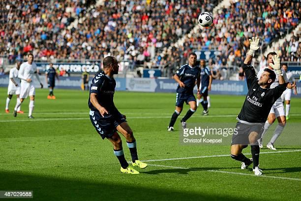Cafu of Laureus Allstaers kicks the ball over Pedro Contreras of Real Madrid Legends during the Laureus KickOffForGood Charity Match between Laureus...