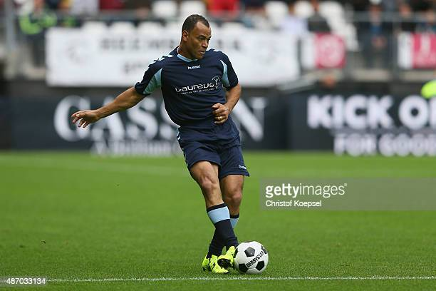 Cafu of Laureus Allstaers runs with the ball during the Laureus KickOffForGood Charity Match between Laureus All Stars against Real Madrid Legends at...