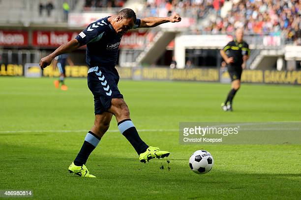 Cafu of Laureus Allstaers shoots the ball during the Laureus KickOffForGood Charity Match between Laureus All Stars against Real Madrid Legends at...