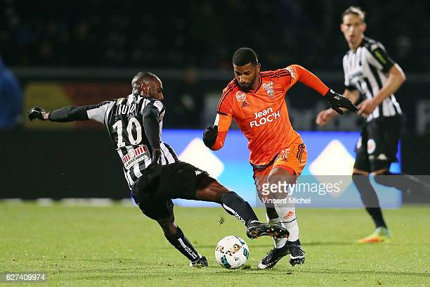 Cafu of Lorient and Gilles Sunu of Angers during the Ligue 1 match between Angers SCO and FC Lorient on December 3 2016 in Angers France