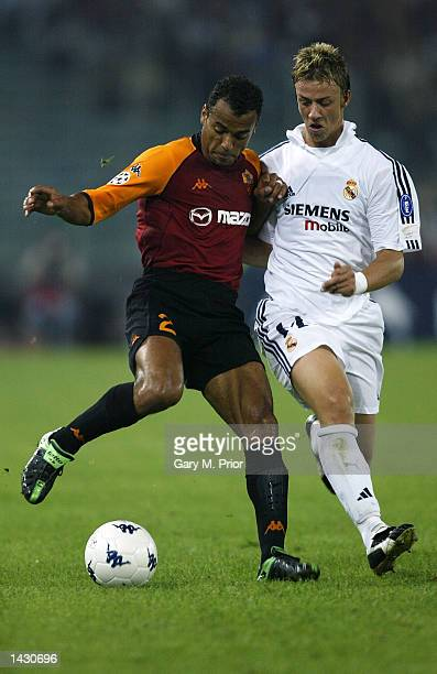 Cafu of Roma is challenged by Guti of Real Madrid during the UEFA Champions League First Phase Group C match between AS Roma and Real Madrid at the...