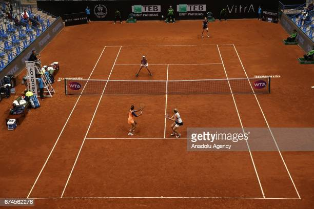 Cagla Buyukakcay of Turkey and Timea Babos of Hungary in action against Nicole Melicha of United States Elise Mertens of Belgium during the TEB BNP...