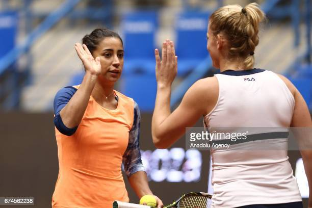 Cagla Buyukakcay of Turkey celebrates with Timea Babos of Hungary during the TEB BNP Paribas Istanbul Cup Women's Couple tennis match between Cagla...