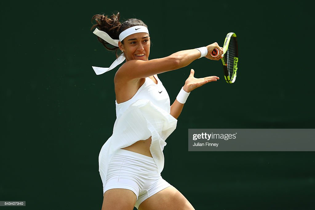 Cagla Buyukakcay of Turkey plays a forehand during the Ladies Singles first round match against Caroline Garcia of France on day two of the Wimbledon Lawn Tennis Championships at the All England Lawn Tennis and Croquet Club on June 28, 2016 in London, England.