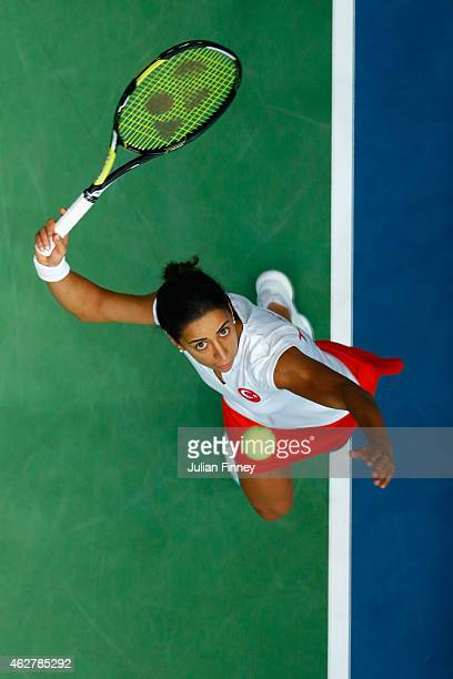 Cagla Buyukakcay of Turkey serves to Heather Watson of Great Britain during day two of the Fed Cup/Africa Group One tennis at Syma Event and Congress...