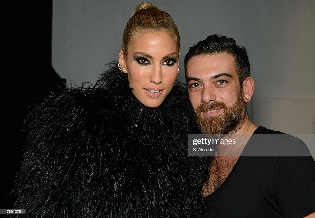 Cagla Sikel and designer Hakan Akkaya pose backstage at the Hakan Akkaya show during MBFWI presented by American Express Fall/Winter 2014 on March 15, 2014 in Istanbul, Turkey.
