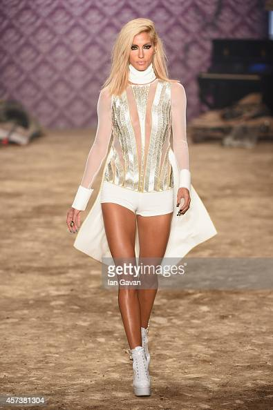 Cagla Sikel walks the runway at the Hakan Akkaya show during Mercedes Benz Fashion Week Istanbul SS15 at Antrepo 3 on October 17 2014 in Istanbul...