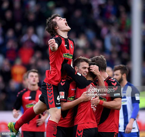 Caglar Soeyuencue Janik Haberer Vincenzo Grifo and Florian Niederlechner of SC Freiburg celebrate the opening goal of Janik Haberer during the...