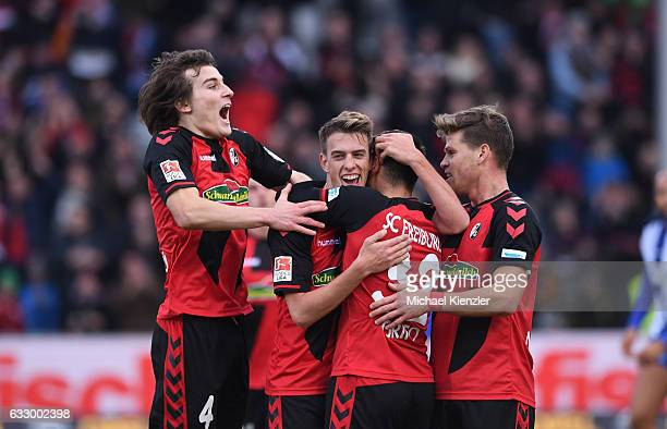 Caglar Soeyuencue Janik Haberer Vincenzo Grifo and Florian Niederlechner of SC Freiburg celerating opening goal of Haberer during the Bundesliga...