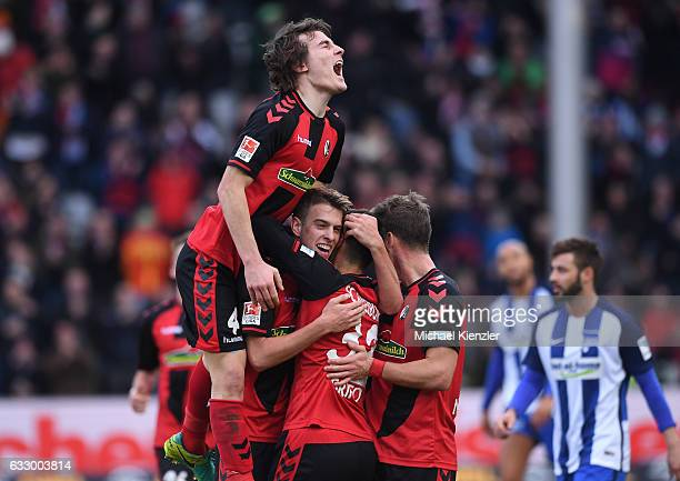 Caglar Soeyuencue Janik Haberer Vincenzo Grifo and Florian Niederlechner celebrating the opening goal of Haberer during the Bundesliga match between...
