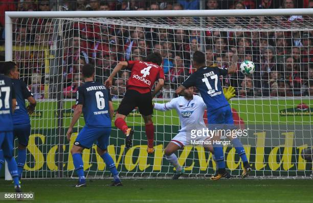 Caglar Soyuncu of SC Freiburg scores the goal past Oliver Baumann of 1899 Hoffenheim during the Bundesliga match between SportClub Freiburg and TSG...