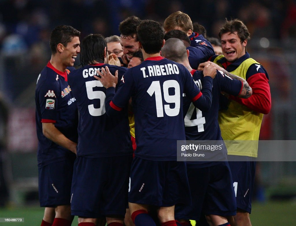 Cagliari Calcio players celebrates the fourth team's goal scored by <a gi-track='captionPersonalityLinkClicked' href=/galleries/search?phrase=Francesco+Pisano&family=editorial&specificpeople=2366269 ng-click='$event.stopPropagation()'>Francesco Pisano</a> during the Serie A match between AS Roma and Cagliari Calcio at Stadio Olimpico on February 1, 2013 in Rome, Italy.