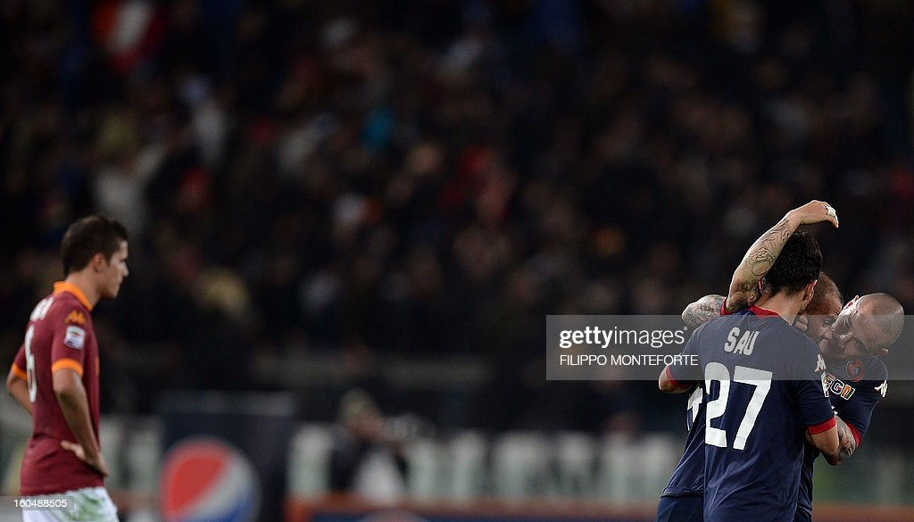 Cagliari defender Francesco Pisan celebrates with teamates after scoring during the Serie A football match AS Roma vs Cagliari in Rome's Olympic Stadium on Febuary 1, 2013. AFP PHOTO / FILIPPO MONTEFORTE