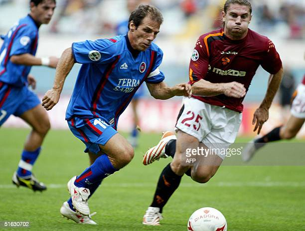 Cagliari's captain Gianfranco Zola vies AS Roma's Damian Leandro Cufre during their Serie A football match at the Olympic Stadium in Rome 31 October...