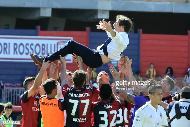 Cagliari's coach Massimo Rastelli celebrates the win with the players during the Serie A match between Cagliari Calcio and AC Milan at Stadio...