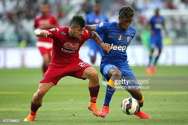 Cagliari's defender Antonio Balzano fights for the ball with Juventus' French midfielder Kingsley Coman during the Italian Serie A football match...