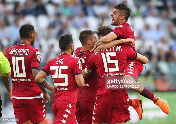 Cagliari's defender Luca Rossettini celebrates with teammates after scoring a goal during the Italian Serie A football match Juventus vs Cagliari on...