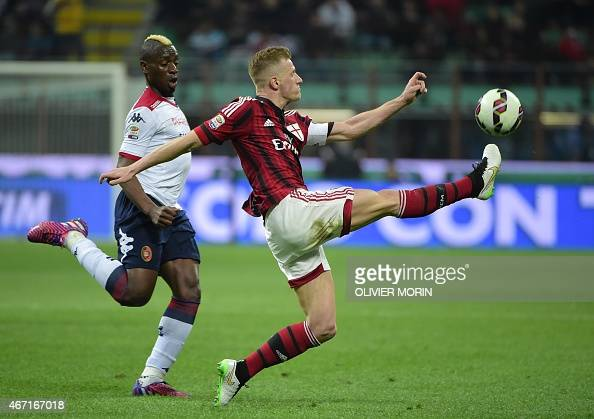 Cagliari's forward M'poku fights for the ball with AC Milan's defender Ignazio Abate during the Italian Serie A football match AC Milan vs Cagliari...