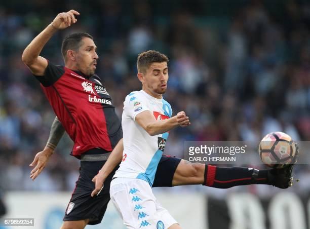 Cagliari's Italian forward Marco Borriello fights for the ball with Napoli's Italian midfielder Brazilianborn Jorginho during the Italian Serie A...