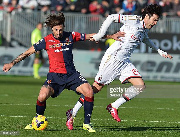 Cagliari's midfielder Daniele Conti vies with AC Milan's Brazilian forward Kaka during the Italian Serie A football match between Cagliari and AC...