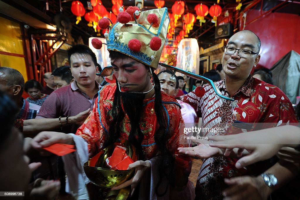 Cai Sen Ye (God of Fortune) gives Ang Pao to devotees during Chinese New Year celebrations at Hong San Ko Tee Temple. The Chinese New Year known as the Spring festival or the Lunar New Year celebrate on February 8th, welcoming the Year of the Monkey. Chinese New Year is the most important festival in the Chinese calendar and is widely celebrated across Asia.