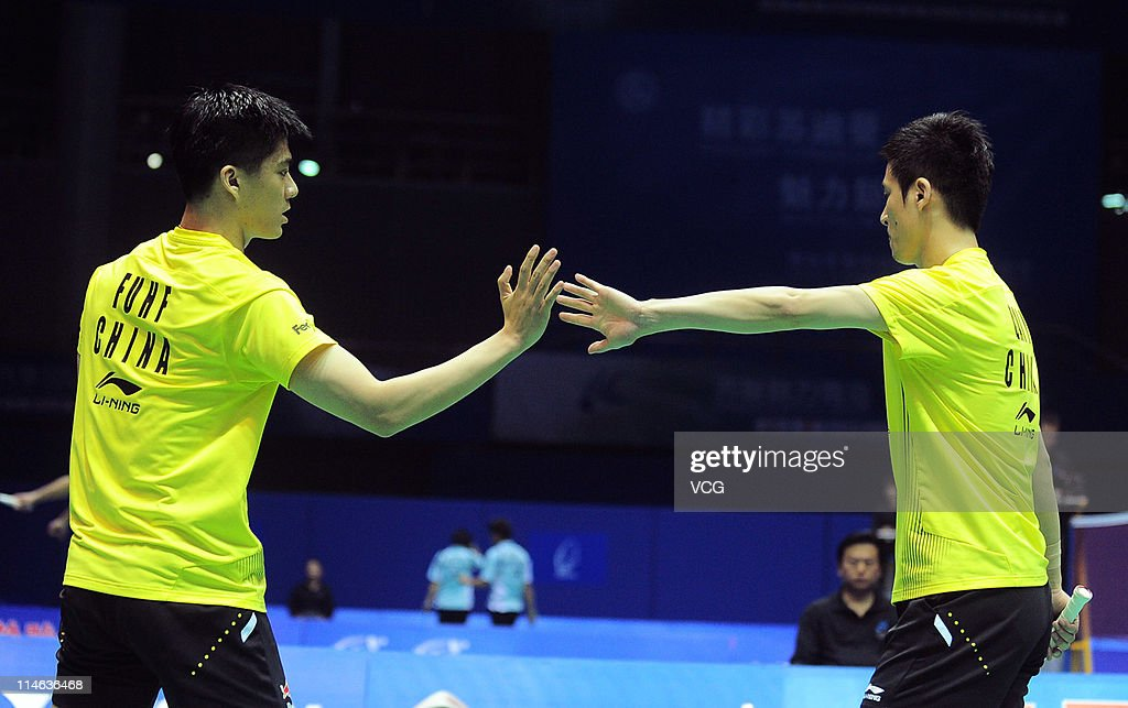 <a gi-track='captionPersonalityLinkClicked' href=/galleries/search?phrase=Cai+Yun&family=editorial&specificpeople=651352 ng-click='$event.stopPropagation()'>Cai Yun</a> and Fu Haifeng of China celebrate after a shot during their match against Shoji Sato and Naoki Kawamae of Japan during day three of the 12th Sudirman Cup at Qingdao Sports Center on May 24, 2011 in Qingdao, Shandong Province of China.