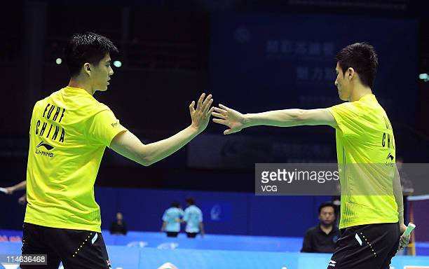Cai Yun and Fu Haifeng of China celebrate after a shot during their match against Shoji Sato and Naoki Kawamae of Japan during day three of the 12th...