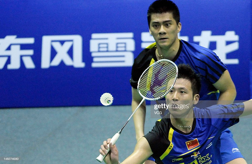 <a gi-track='captionPersonalityLinkClicked' href=/galleries/search?phrase=Cai+Yun&family=editorial&specificpeople=651352 ng-click='$event.stopPropagation()'>Cai Yun</a> (R) and Fu Haifeng of China compete against Shoji Sato and Naoki Kawamae of Japan in the semi-final match during the Thomas Cup world badminton team championships at Wuhan Sports Gymnasium Center on May 25, 2012 in Wuhan, China.