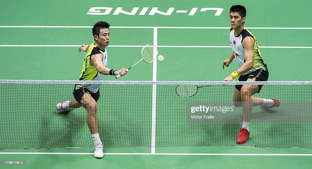 <a gi-track='captionPersonalityLinkClicked' href=/galleries/search?phrase=Cai+Yun&family=editorial&specificpeople=651352 ng-click='$event.stopPropagation()'>Cai Yun</a> (R) and Fu Haifeng of China in action during their match against Mohammad Ahsan and Hendra Setiawan of Indonesia during the Badminton World Championships at the Tianhe Gymnasium on August 10, 2013 in Guangzhou, China.