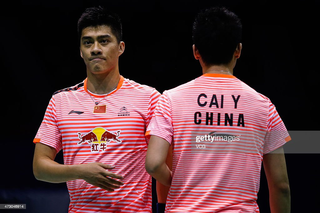 <a gi-track='captionPersonalityLinkClicked' href=/galleries/search?phrase=Cai+Yun&family=editorial&specificpeople=651352 ng-click='$event.stopPropagation()'>Cai Yun</a> and Fu Haifeng of China react during Men's Doubles match against Bodin Issara and Pakkawat Vilailak of Thailand on day three of 2015 Sudirman Cup BWF World Mixed Team Championships on May 12, 2015 in Dongguan, Guangdong province of China.