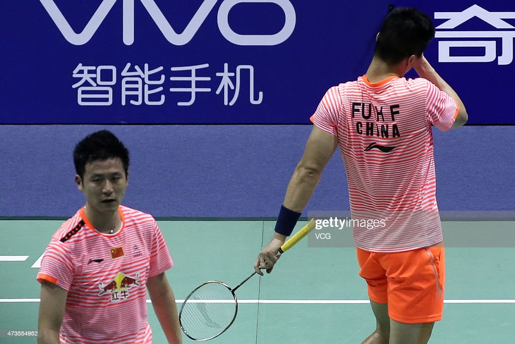 <a gi-track='captionPersonalityLinkClicked' href=/galleries/search?phrase=Cai+Yun&family=editorial&specificpeople=651352 ng-click='$event.stopPropagation()'>Cai Yun</a> and Fu Haifeng of China react during Men's Doubles match against Mohammad Ahsan and Hendra Setiawan of Indonesia in the semi-finals on day seven of 2015 Sudirman Cup BWF World Mixed Team Championships on May 16, 2015 in Dongguan, Guangdong province of China.