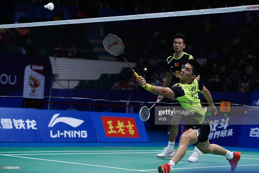 <a gi-track='captionPersonalityLinkClicked' href=/galleries/search?phrase=Cai+Yun&family=editorial&specificpeople=651352 ng-click='$event.stopPropagation()'>Cai Yun</a> and Fu Haifeng of China react during the men's double match against Kenichi Hayakawa and Hiroyuki Endo of Japan on day five of the 2013 BWF World Championships at Tianhe Sports Center on August 9, 2013 in Guangzhou, Guangdong Province of China.
