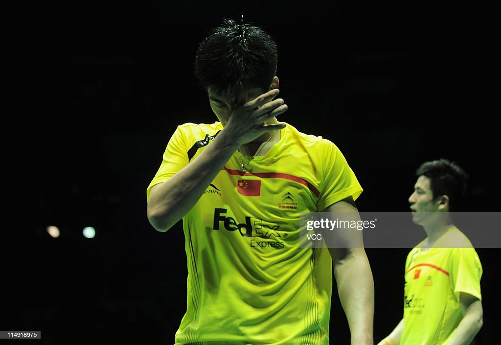 <a gi-track='captionPersonalityLinkClicked' href=/galleries/search?phrase=Cai+Yun&family=editorial&specificpeople=651352 ng-click='$event.stopPropagation()'>Cai Yun</a> and Fu Haifeng of China reacts after their match against Jung Jaesung and Lee Yongdae of South Korea during day seven of the the 2011 Sudirman Cup - World Mixed Team Championships at Qingdao Sports Center on May 28, 2011 in Qingdao, Shandong Province of China.