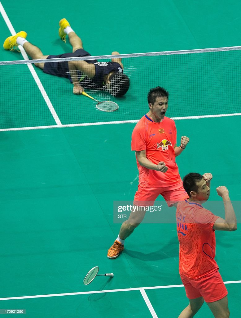 Cai Yun C and Lu Kai R of China celebrate winning against