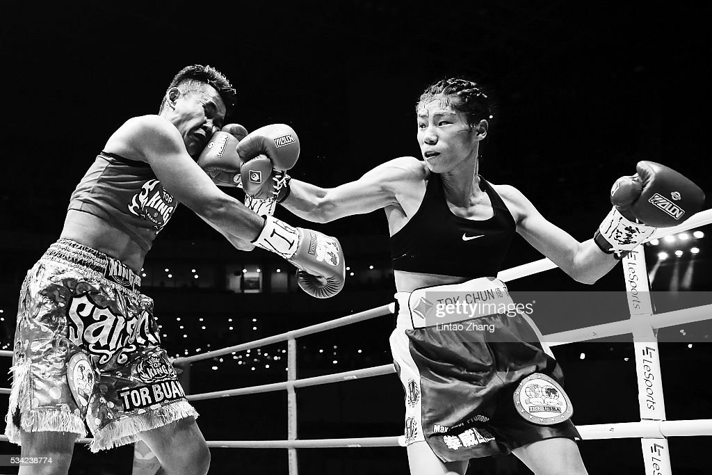 Cai Zongju of China (R) delivers a punch to Samson Tor Buamas of Thailand during their IBF Intercontinental Mini Flyweight Championship boxing match at Beijing Olympic park diamond stadium on May 25, 2016 in Beijing, China.