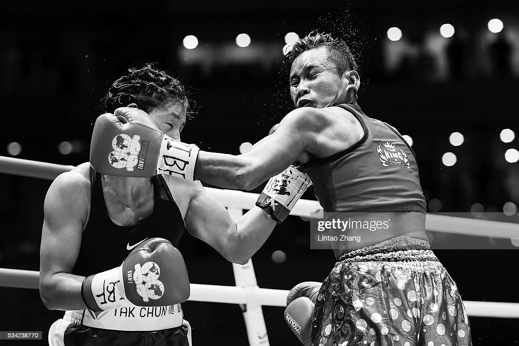 Cai Zongju (L) of China punches Samson Tor Buamas of Thailand in the head during their IBF Female Intercontinental Mini Flyweight Championship boxing match at Beijing Olympic park diamond stadium on May 25, 2016 in Beijing, China.