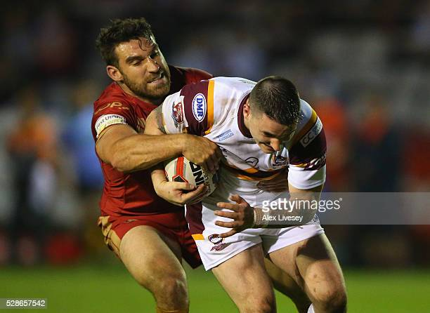 Cain Southernwood of Batley Bulldogs is tackled by Thomas Bosc of Catalan Dragons during the Ladbrokes Challenge Cup Sixth Round match between Batley...