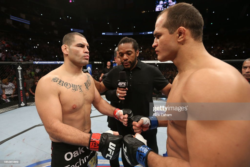 Cain Velasquez and Junior Dos Santos touch gloves before their UFC heavyweight championship bout at the Toyota Center on October 19, 2013 in Houston, Texas.