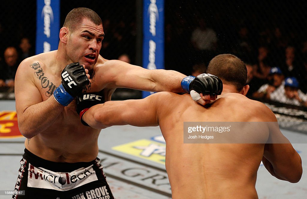 Cain Velasquez and Junior dos Santos trade punches during their heavyweight championship fight at UFC 155 on December 29, 2012 at MGM Grand Garden Arena in Las Vegas, Nevada.