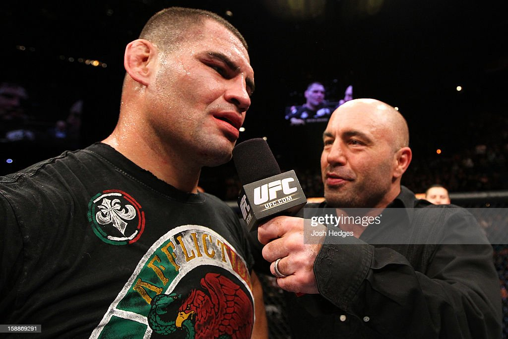 Cain Velasquez is interviewed by Joe Rogan after defeating Junior dos Santos during their heavyweight championship fight at UFC 155 on December 29, 2012 at MGM Grand Garden Arena in Las Vegas, Nevada.