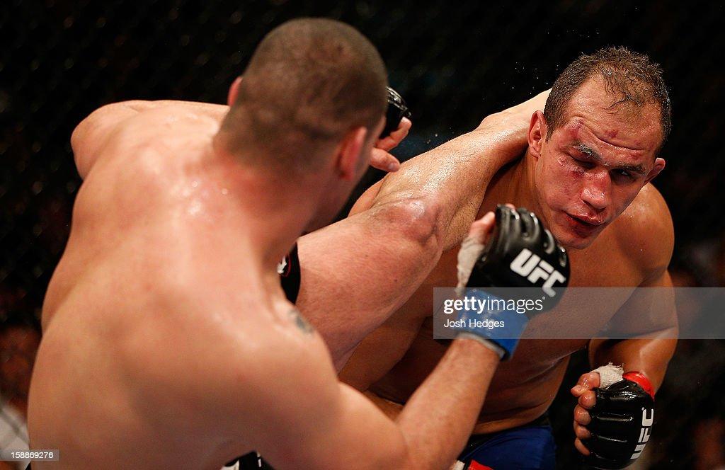 Cain Velasquez kicks Junior dos Santos during their heavyweight championship fight at UFC 155 on December 29, 2012 at MGM Grand Garden Arena in Las Vegas, Nevada.